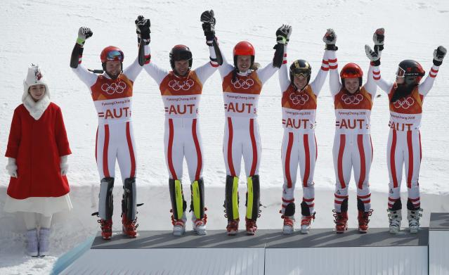 Alpine Skiing - Pyeongchang 2018 Winter Olympics - Team Event - Yongpyong Alpine Centre - Pyeongchang, South Korea - February 24, 2018 - Silver medallist Austria's team celebrates on the podium during the victory ceremony. REUTERS/Mike Segar