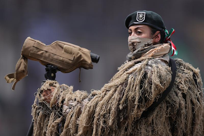 VARIOUS CITIES, MEXICO - SEPTEMBER 16: A soldier looks on during the Independence Day military parade at Zocalo Square on September 16, 2020 in Various Cities, Mexico. This year El Zocalo remains closed for general public due to coronavirus restrictions. Every September 16 Mexico celebrates the beginning of the revolution uprising of 1810. (Photo by Hector Vivas/Getty Images)