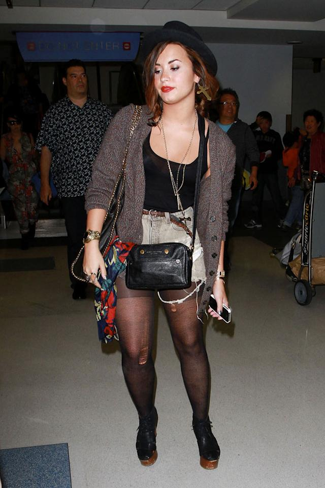 "Also spotted in a pair of catastrophic cutoffs ... ""Skyscraper"" songstress Demi Lovato, who looked far from fabulous upon arriving at LAX in a dingy getup, complete with shredded stockings. Anthony/<a href=""http://www.pacificcoastnews.com/"" target=""new"">PacificCoastNews.com</a> - September 21, 2011"