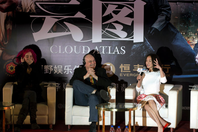 """FILE - In this Jan. 21, 2013 file photo, Lana Wachowski, left,  and Andy Wachowski, center, co-writers and co-directors of """"Cloud Atlas,"""" look on as Chinese actress and cast member Zhou Xun, right, speaks during a press conference held ahead of the movie's China premiere in Beijing, China. Nearly 40 minutes has been chopped from China's version of the soon-to-be-released Hollywood film """"Cloud Atlas,"""" deleting both gay and straight love scenes to satisfy local censors despite a movie-going public that increasingly chafes at censorship. (AP Photo/Ng Han Guan, File)"""