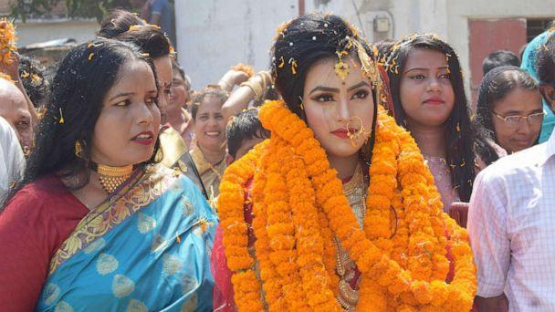 PHOTO:Relatives of groom Tariqul Islam welcome bride Khadiza Akter Khushi with a floral wreath as she arrives to groom's house during their wedding in Meherpur, Sept. 21, 2019. (Handout/AFP/Getty Images)