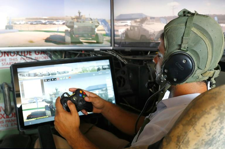 One of the tank systems, developed by Elbit Systems, is operated using a controller like that of a video game console (AFP Photo/JACK GUEZ)