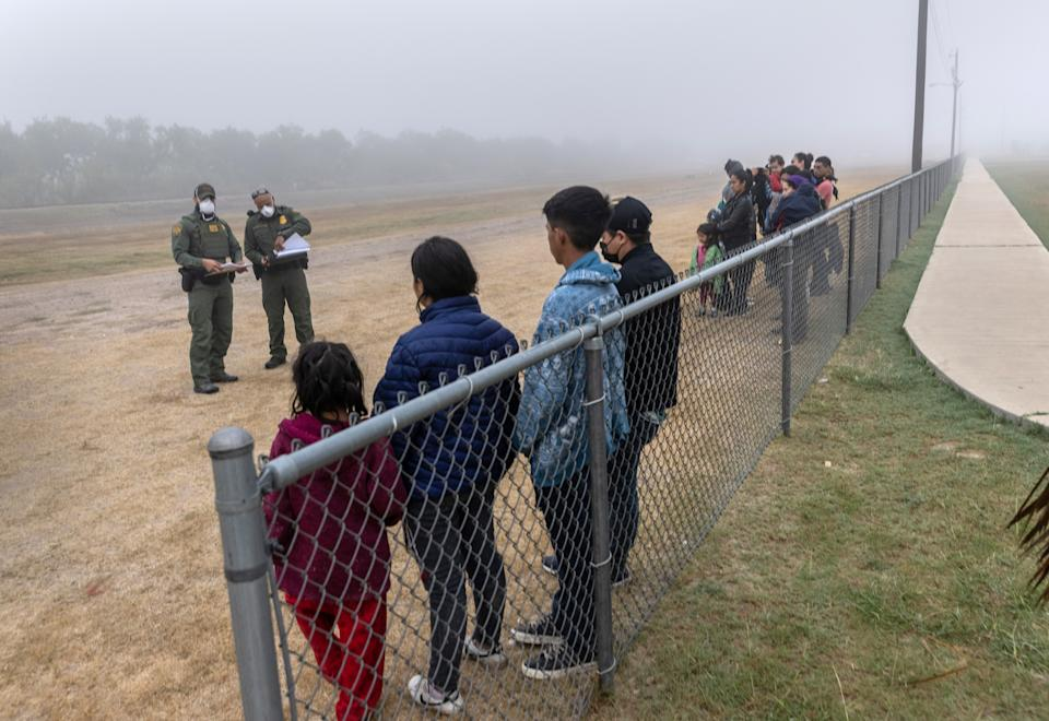 Unaccompanied minors are grouped apart from families waiting to be processed by U.S. Border Patrol agents near the U.S.-Mexico border on April 10, 2021 in La Joya, Texas. A surge of immigrants crossing into the United States, including record numbers of children, continues along the southern border. (John Moore/Getty Images)