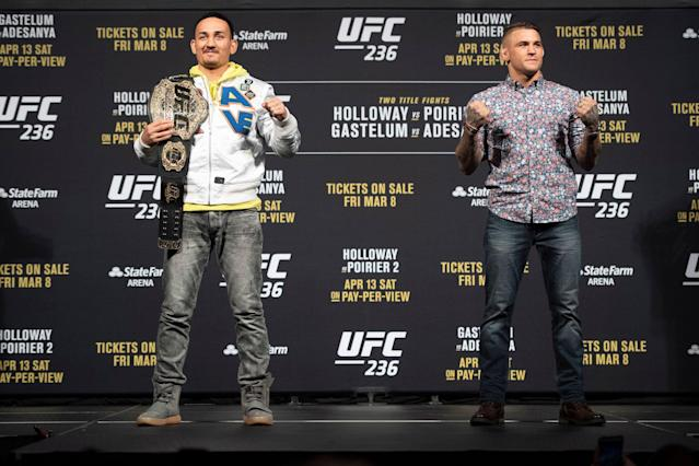 UFC featherweight champion Max Holloway (L) and Dustin Poirier during the UFC 236 press conference on Friday, Mar. 1, 2019 in Las Vegas. (Getty Images)