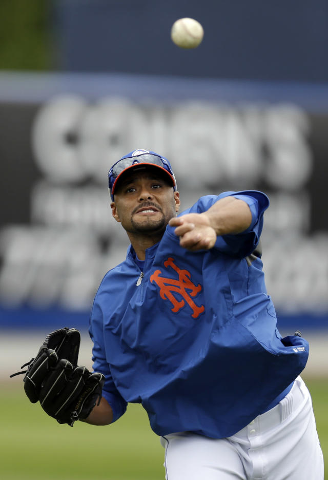 In this March 1, 2013, photo, New York Mets starting pitcher Johan Santana throws while working out before the Mets' spring training baseball game against the Detroit Tigers in Port St. Lucie, Fla. The Mets say Santana has injured his left shoulder again and likely will need surgery and miss the 2013 season. The two-time Cy Young Award winner missed the 2011 season following shoulder surgery in September 2010, then returned last year and pitched the first no-hitter in the team's history. He hasn't pitched in an exhibition game this year because of arm weakness. (AP Photo/Julio Cortez)