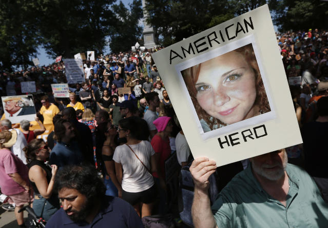 """<p>A counterprotester holds a photo of Heather Heyer on Boston Common at a """"Free Speech"""" rally organized by conservative activists, Saturday, Aug. 19, 2017, in Boston, Mass. Heyer was killed last Saturday when a car, allegedly driven by James Alex Fields Jr., that plowed into a group of people during protests in Charlottesville, Va. (Photo: Michael Dwyer/AP) </p>"""