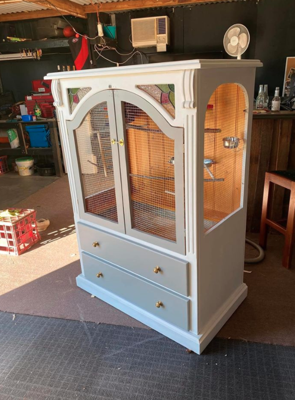 old tv unit transformed into a white birdcage