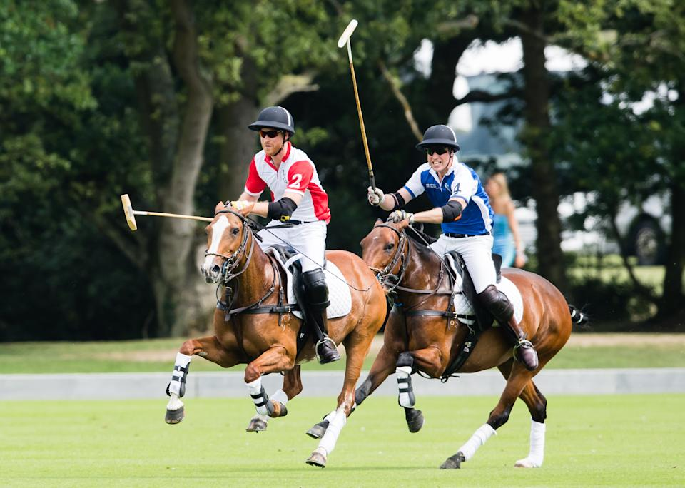 WOKINGHAM, ENGLAND - JULY 10: Prince William, Duke of Cambridge and Prince Harry, Duke of Sussex play during The King Power Royal Charity Polo Day at Billingbear Polo Club on July 10, 2019 in Wokingham, England. (Photo by Samir Hussein/WireImage)