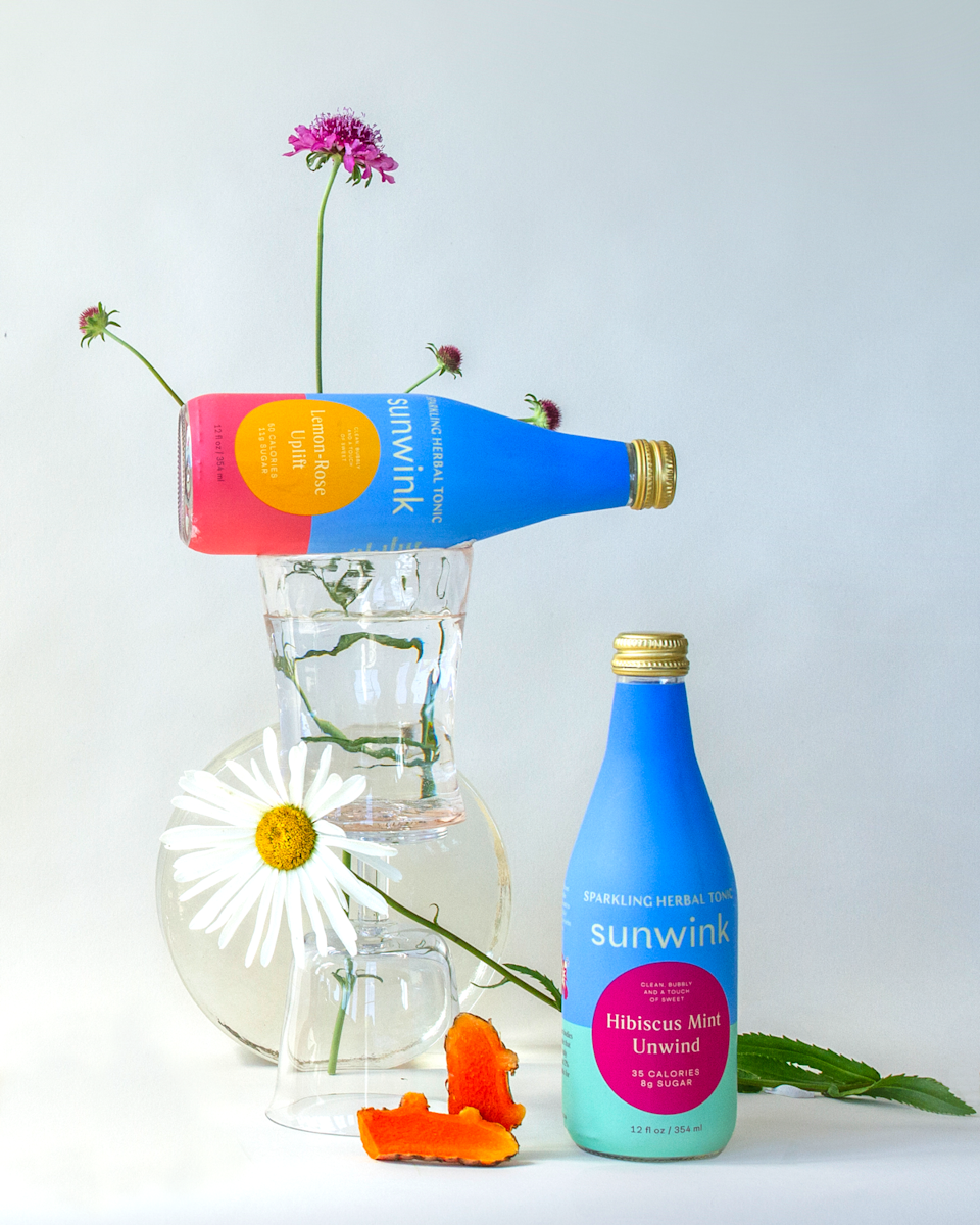 "<h2><h2>Sunwink Sparkling Herbal Tonic De-Stress Pack</h2></h2> <br>""A stay-at-home summer has caused me to get more creative in the refreshment department. So, I'm constantly on the hunt for new sparkly substances that aren't sugar bombs. Enter: Sunwink, a beverage brand led by a dynamic female-founding duo. These vibrant bottles are filled with an herbal-blended effervescent liquid that's described as a 'wellness tonic.' My favorite is this here de-stressing combo of the Lemon-Rose Uplift and Hibiscus Mint Unwind: each tastes like a mix between premium tea and luxury seltzer. On top of tasting delicious (especially when mixed into a spritz), there's a charitable kickback too: 2% of all sales go back to different organizations tied to each flavor, like the <a href=""https://marshap.org/"" rel=""nofollow noopener"" target=""_blank"" data-ylk=""slk:Marsha P. Johnson"" class=""link rapid-noclick-resp"">Marsha P. Johnson</a> Institute or the <a href=""https://www.amazonfrontlines.org/"" rel=""nofollow noopener"" target=""_blank"" data-ylk=""slk:Amazon Frontlines"" class=""link rapid-noclick-resp"">Amazon Frontlines</a>."" <em>– Elizabeth Buxton, Market Editor</em><br><br><em>Shop <strong><a href=""https://drinksunwink.com/"" rel=""nofollow noopener"" target=""_blank"" data-ylk=""slk:Sunwink"" class=""link rapid-noclick-resp"">Sunwink</a></strong></em><br><br><strong>Sunwink</strong> De-Stress Pack (12), $, available at <a href=""https://go.skimresources.com/?id=30283X879131&url=https%3A%2F%2Fdrinksunwink.com%2Fcollections%2Fsparkling-herbal-tonics%2Fproducts%2Fde-stress-pack"" rel=""nofollow noopener"" target=""_blank"" data-ylk=""slk:Sunwink"" class=""link rapid-noclick-resp"">Sunwink</a><br><br><br>"