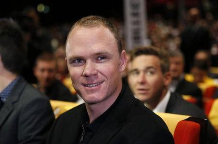 Rider Chris Froome of Britain attends the presentation of the itinerary of the 2017 Tour de France cycling race during a news conference in Paris