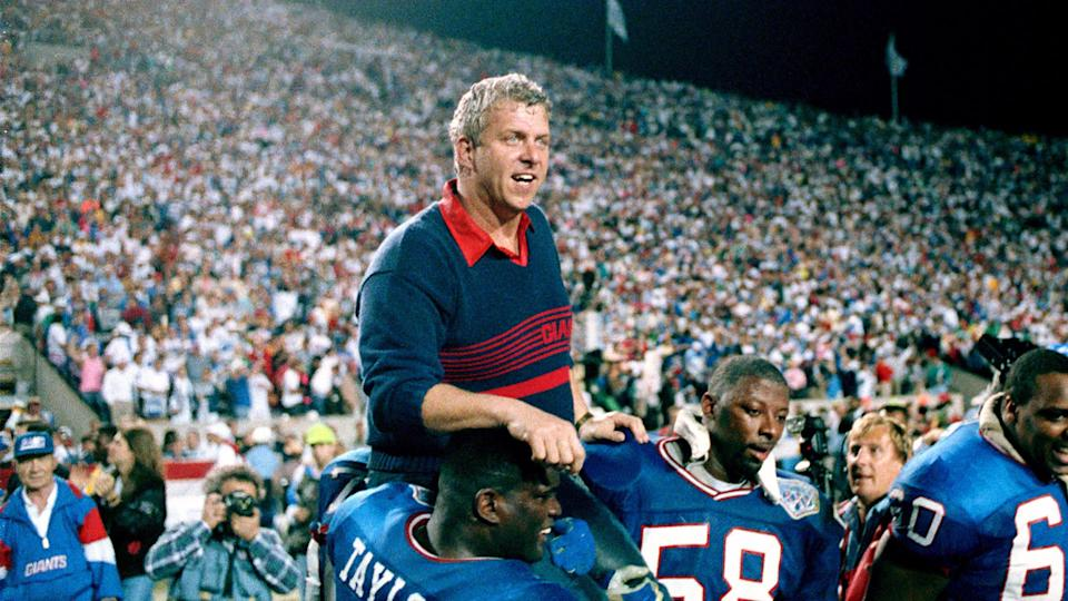 Mandatory Credit: Photo by Ed Reinke/AP/Shutterstock (6545430a)Bill Parcells, Lawrence Taylor, Carl Banks New York Giants coach Bill Parcells is carried on the shoulders of football players Lawrence Taylor (56) and Carl Banks (58) after defeating the Buffalo Bills 20-19 to win Super Bowl XXV in Tampa, FlaCountdown to 50 Super Bowl 25 Football, Tampa, USA.