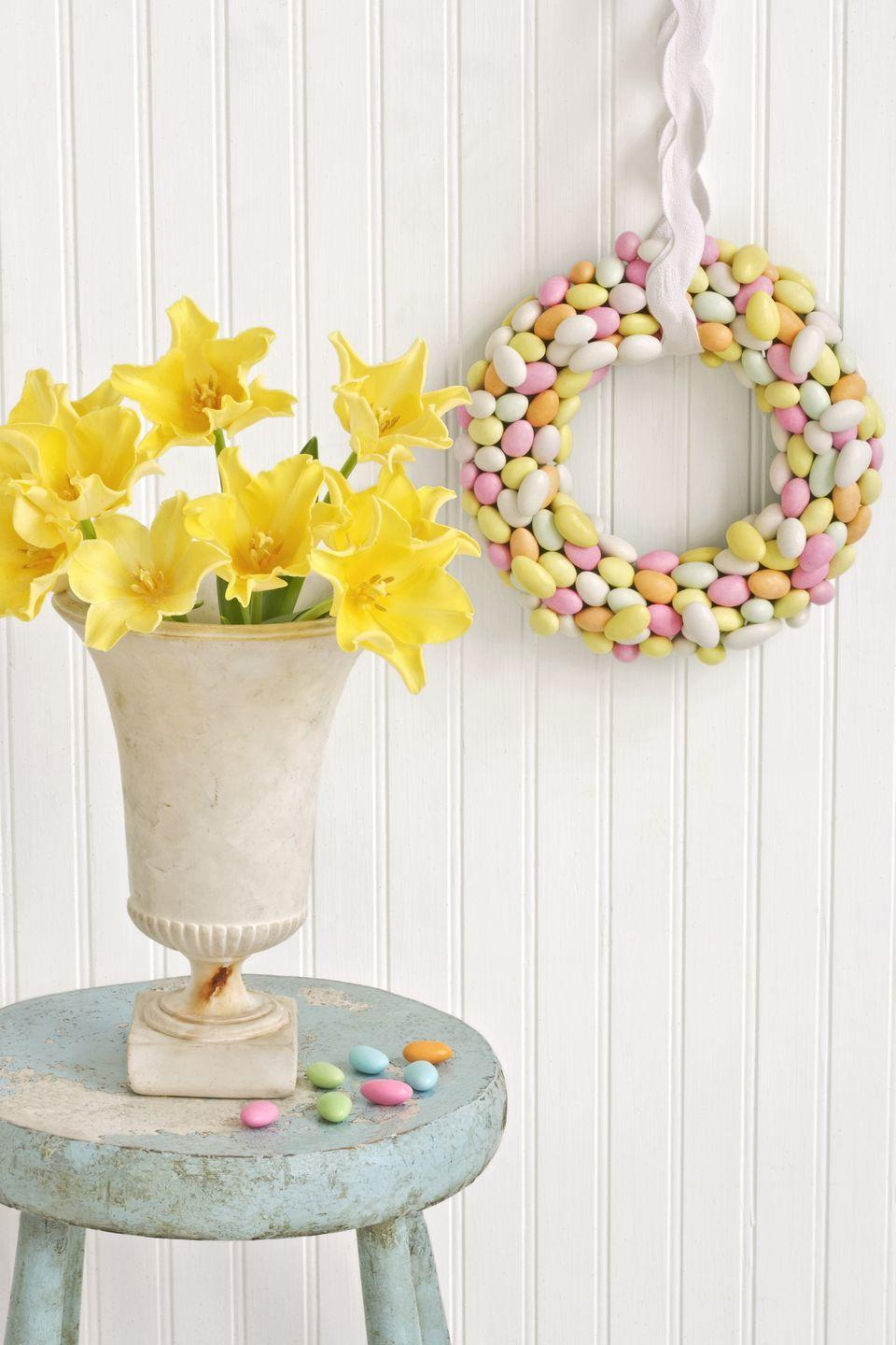 "<p>Egg-shaped Jordan almonds make an especially sweet spring decoration.</p><p><strong>To make:</strong> Take a 12-inch Styrofoam wreath form, and beginning with the inside circumference, hot-glue the almonds in place, overlapping a few of them to add dimension. Continue in a circular pattern until the entire front and inner and outer edges of the wreath are covered. Hang with a sturdy piece of cotton ribbon, or oversize rickrack trim as shown.To store the wreath, wrap it in paper, place flat in a box, and keep in a cool, dry spot. It should last for one to two years.</p><p><a class=""link rapid-noclick-resp"" href=""https://www.amazon.com/Craft-Foam-Wreath-Polystyrene-Decorations/dp/B07FNK6YMB/ref=sr_1_2_sspa?tag=syn-yahoo-20&ascsubtag=%5Bartid%7C10050.g.1652%5Bsrc%7Cyahoo-us"" rel=""nofollow noopener"" target=""_blank"" data-ylk=""slk:SHOP WREATH FORMS"">SHOP WREATH FORMS</a></p>"