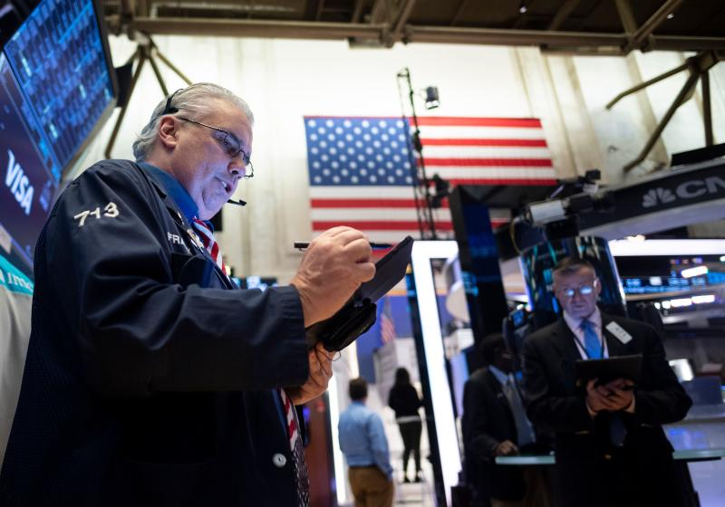 Traders work during the opening bell at the New York Stock Exchange (NYSE) on March 13, 2020 at Wall Street in New York City. (Photo by Johannes EISELE / AFP) (Photo by JOHANNES EISELE/AFP via Getty Images)