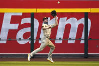 San Diego Padres right fielder Wil Myersmakes the running catch on a ball hit by Arizona Diamondbacks' Kole Calhoun in the first inning during a baseball game, Friday, Aug 14, 2020, in Phoenix. (AP Photo/Rick Scuteri)
