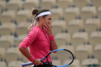 Victoria Azarenka of Belarus reacts after missing a shot against Slovakia's Anna Karolina Schmiedlova in the second round match of the French Open tennis tournament at the Roland Garros stadium in Paris, France, Wednesday, Sept. 30, 2020. (AP Photo/Michel Euler)