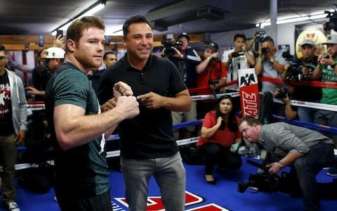 <span>Oscar De La Hoya with Saul Canelo Alvarez. Both fighters have been beaten by Mayweather in the past</span> <span>Credit: Reuters </span>