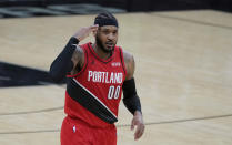 Portland Trail Blazers forward Carmelo Anthony (00) reacts after scoring against the San Antonio Spurs during the second half of an NBA basketball game in San Antonio, Friday, April 16, 2021. (AP Photo/Eric Gay)