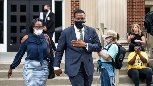 PHOTO: Wanda Cooper, mother of Ahmaud Arbery, and attorney Lee Merritt leave the Glynn County Courthouse on June 4, 2020 in Brunswick, Ga. Gregory and Travis McMichael are charged in the Feb. 23 fatal shooting of Arbery. (Sean Rayford/Getty Images)