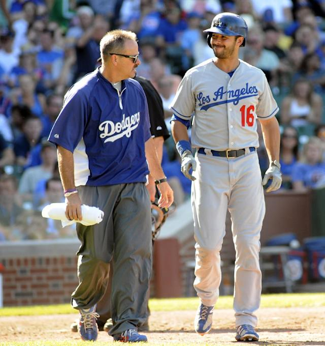 Los Angeles Dodgers' Andre Either reacts after being struck by a pitch in a baseball game against Chicago Cubs, Sunday, Aug. 4, 2013, in Chicago. (AP Photo/Joe Raymond)