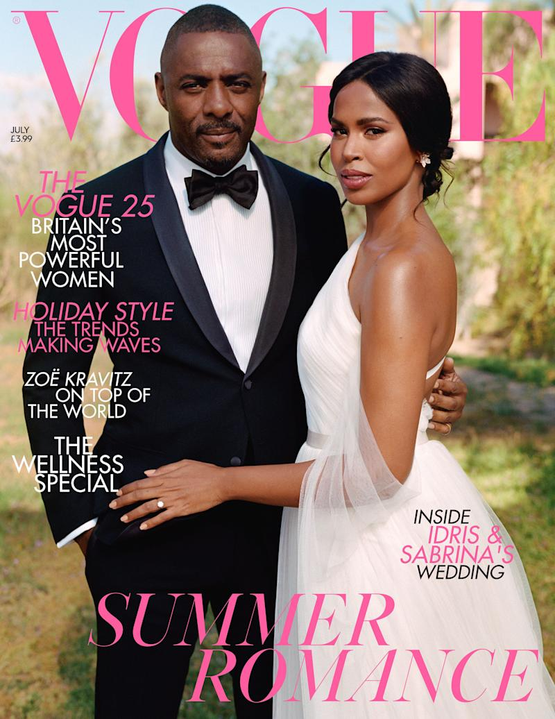 Idris and Sabrina wear luxury formalwear on the British Vogue cover. [Photo: Sean Thomas/British Vogue]