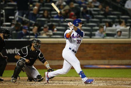 FILE PHOTO: May 11, 2019; New York City, NY, USA; New York Mets right fielder Michael Conforto (30) hits a single in the fourth inning against the Miami Marlins at Citi Field. Mandatory Credit: Noah K. Murray-USA TODAY Sports