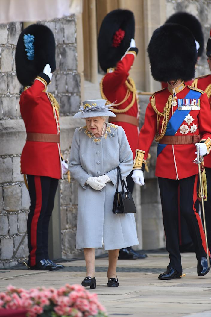 Queen Elizabeth II during a ceremony at Windsor Castle in Berkshire to mark her official birthday. Picture date: Saturday June 12, 2021.