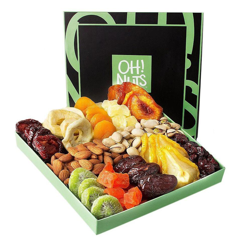"""<p><strong>Oh! Nuts</strong></p><p>amazon.com</p><p><strong>$29.99</strong></p><p><a href=""""http://www.amazon.com/dp/B01136INBW/?tag=syn-yahoo-20&ascsubtag=%5Bartid%7C2089.g.2177%5Bsrc%7Cyahoo-us"""" rel=""""nofollow noopener"""" target=""""_blank"""" data-ylk=""""slk:Shop Now"""" class=""""link rapid-noclick-resp"""">Shop Now</a></p><p>Whether you're hosting a charcuterie night at home or gifting to your favorite foodie, this best-seller is most certainly not your average fruit basket.</p><p>Filled with gourmet goodies and snacks including dried nectarines, diced pineapple, Turkish apricots, and an assortment of crunchy nuts, this food gift basket makes the perfect gift for a friend who just moved or the health-conscious.</p>"""