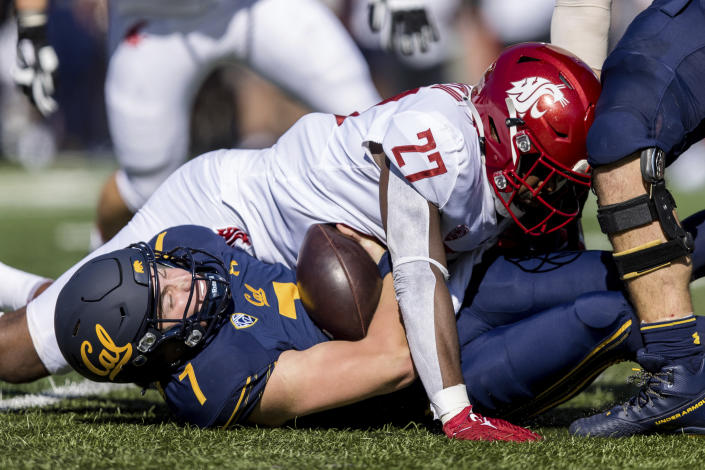Washington State defensive end Willie Taylor III (27) sacks California quarterback Chase Garbers (7) in the first quarter of an NCAA college football game in Berkeley, Calif., Saturday, Oct. 2, 2021. (AP Photo/John Hefti)
