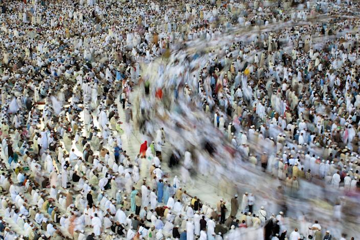 Tens of thousands of Muslim pilgrims moving around the Kaaba, unseen, inside the Grand Mosque, in Mecca, Saudi Arabia, Sunday, Oct. 30, 2011. The annual Islamic pilgrimage draws 2.5 million visitors each year, making it the largest yearly gathering of people in the world. The Hajj will start on 5 November. (AP Photo/Hassan Ammar)