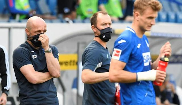 Hoffenheim coach Alfred Schreuder wore a mask on the sidelines during his side's defeat to Hertha Berlin (AFP Photo/THOMAS KIENZLE)