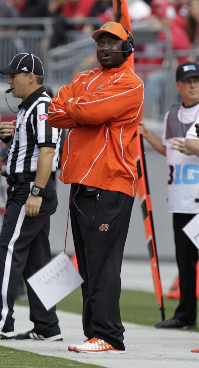 Florida A&M head coach Earl Holmes watches from the sideline during the first quarter of an NCAA college football game against Ohio State Saturday, Sept. 21, 2013, in Columbus, Ohio. (AP Photo/Jay LaPrete)