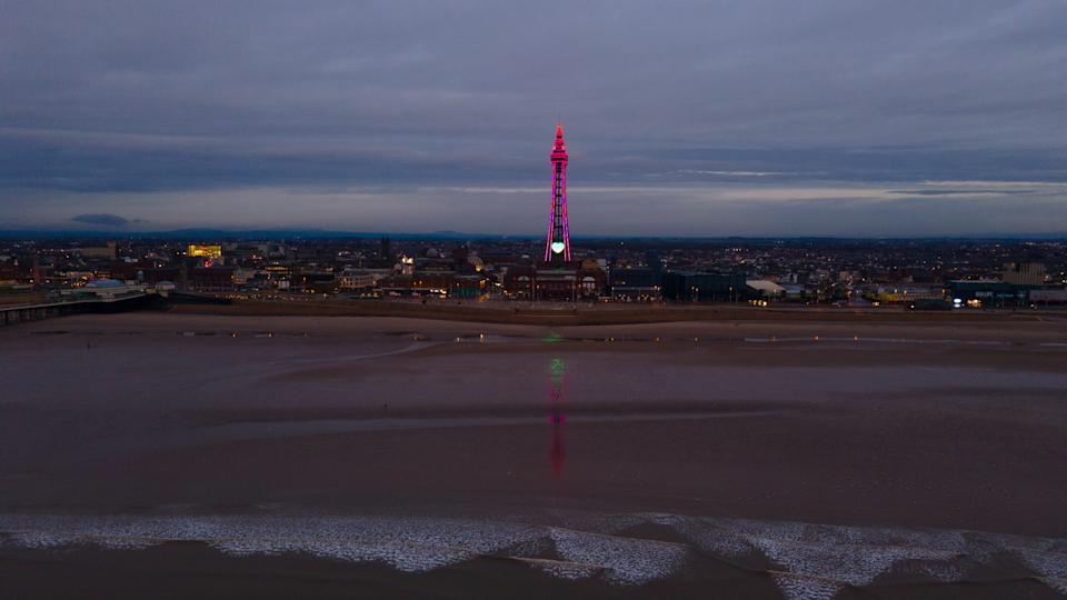 Photo taken with permission from the Twitter feed of @Lancashiredron1 of Blackpool Tower lit up on Wednesday night in commemoration to Jordan Banks, who died after being struck by lightning. His family have paid tribute to him, saying