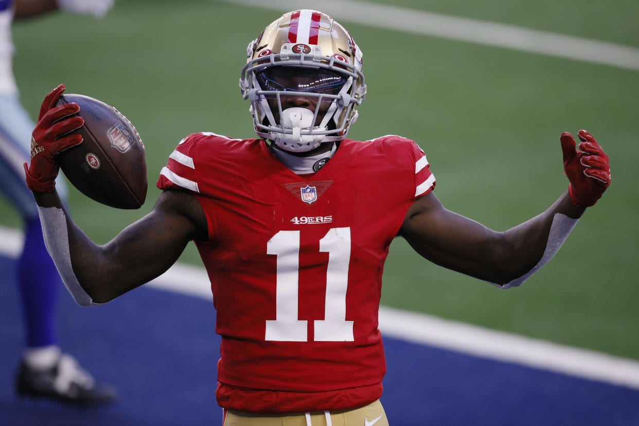 ARLINGTON, TEXAS - DECEMBER 20: Wide receiver Brandon Aiyuk #11 of the San Francisco 49ers celebrates a touchdown against the Dallas Cowboys during the second quarter at AT&T Stadium on December 20, 2020 in Arlington, Texas. (Photo by Tom Pennington/Getty Images)
