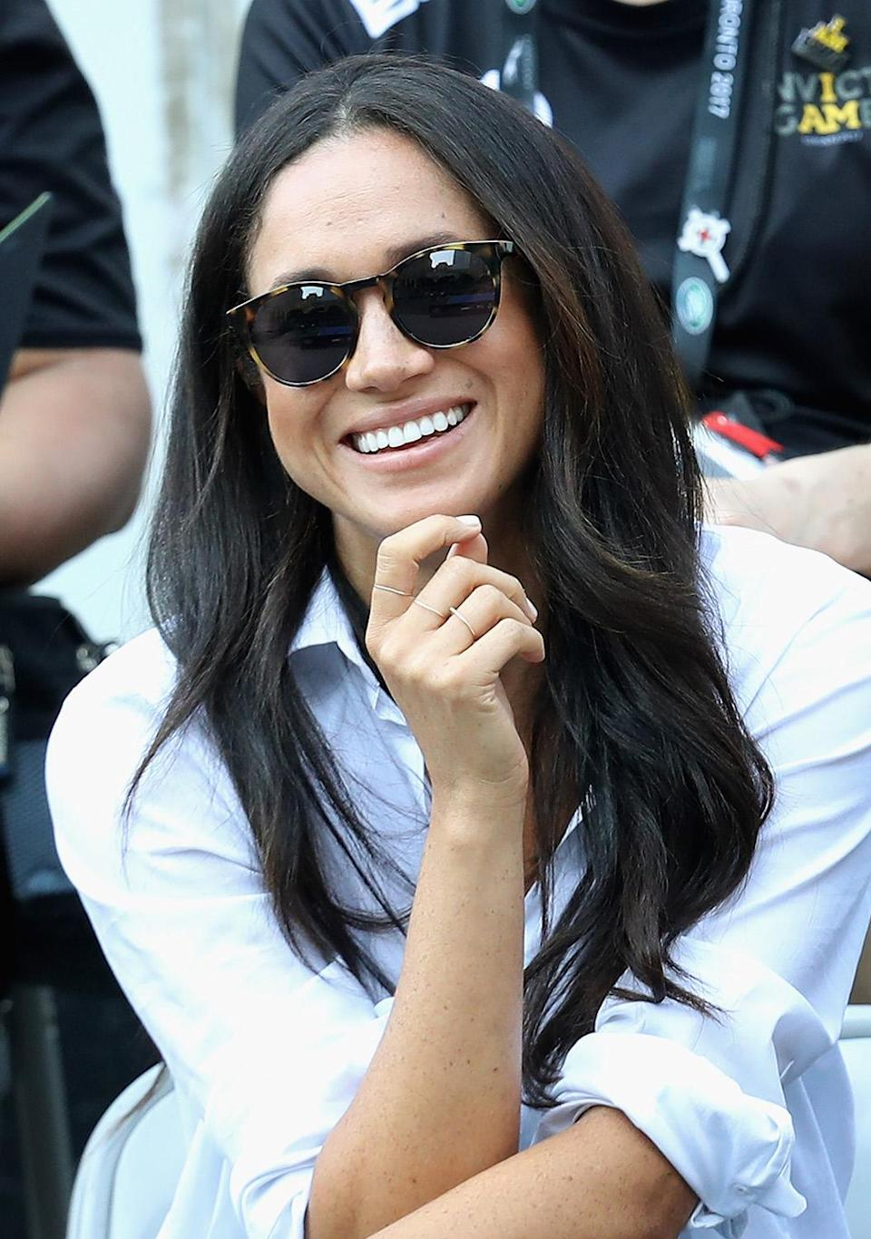 <p>Markle switches up her hair a lot, but this just might be her go-to signature look. (Photo: Chris Jackson/Getty Images for the Invictus Games Foundation) </p>