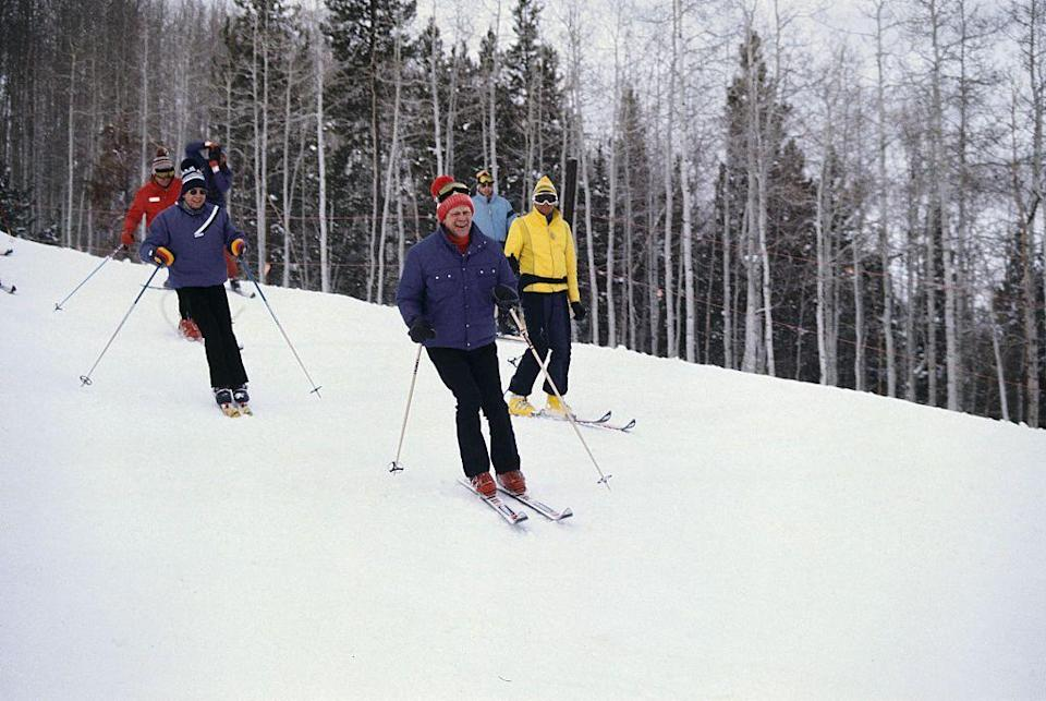 <p>Gerald Ford gives onlookers a huge smile as he makes his way down the mountain in Vail, Colorado in 1974, with his security detail in tow, of course. </p>