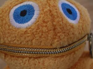 Soft toy with zipper mouth