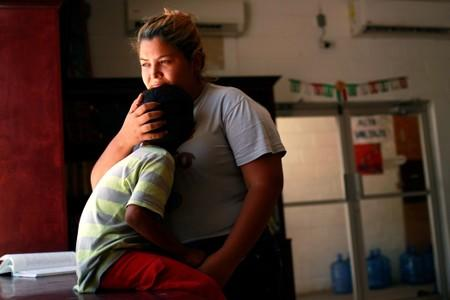 Honduran migrant Denia Carranza and her son Robert, who have given up their U.S. asylum claim under the Migrant Protection Protocol (MPP), pose for a photo at Casa del Migrante migrant shelter, in Ciudad Juarez