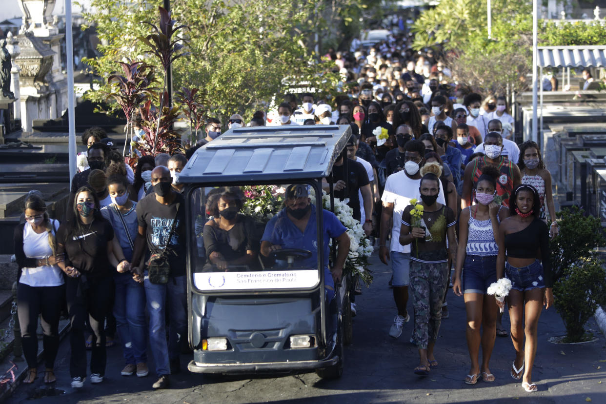 Family and friends accompany the coffin that contain the remains of Kathlen Romeu, a young pregnant woman killed by a stray bullet, at a cemetery in Rio de Janeiro, Brazil, Wednesday, June 9, 2021. Stray bullets have struck at least six pregnant women in Rio since 2017, but Romeu was the first to die, according to Crossfire, a non-governmental data project that tracks armed violence. (AP Photo/Bruna Prado)