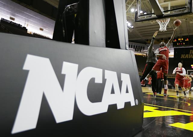 Louisville forward Asia Taylor drives to the basket during practice for the NCAA women's college basketball tournament, Saturday, March 22, 2014, in Iowa City, Iowa. Louisville plays Idaho in a first-round game on Sunday. (AP Photo/Charlie Neibergall)