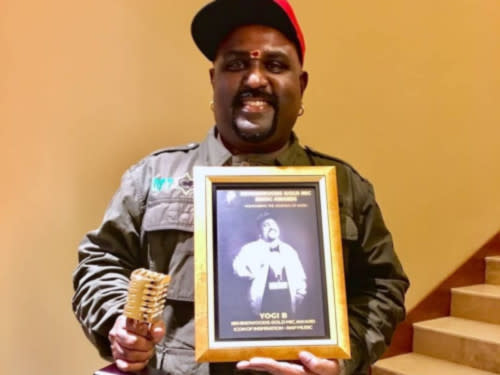Yogi B with his Icon of Inspiration - Rap Music Award (Photo source: Yogi B's Facebook).