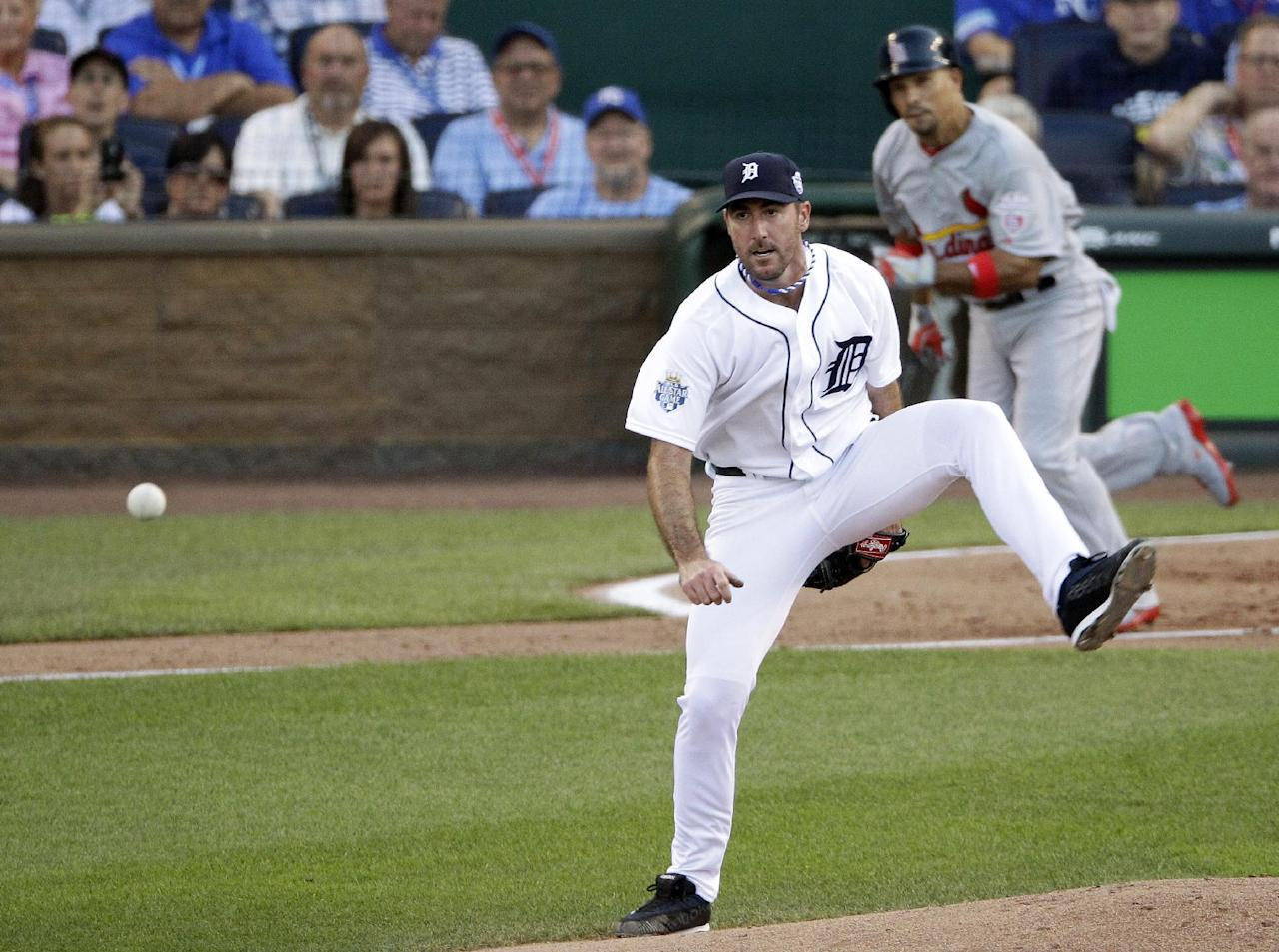 American League's Justin Verlander, of the Detroit Tigers, misses a grounder from National League's Rafael Furcal, of the St. Louis Cardinals, in the first inning of the MLB All-Star baseball game, Tuesday, July 10, 2012, in Kansas City, Mo. Furcal hit into a force out to end the inning. (AP Photo/Charlie Neibergall)