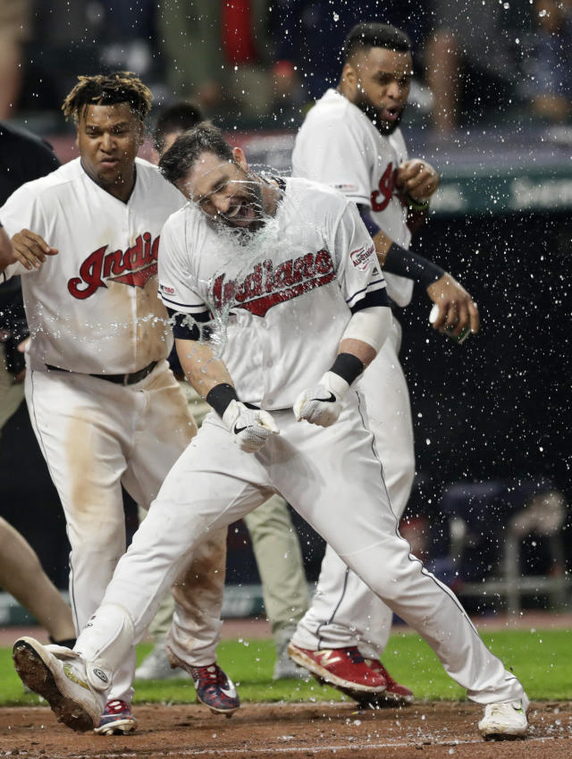 Cleveland Indians' Jason Kipnis celebrates with teammates after hitting a solo home run in the 10th inning in a baseball game against the Kansas City Royals, early Tuesday, June 25, 2019, in Cleveland. The Indians won 3-2 in 10 innings. (AP Photo/Tony Dejak)