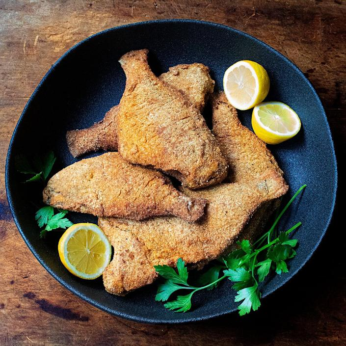 <p>Porgy, also referred to as scup or bream, is a medium-fatty, firm-fleshed white fish with a mild flavor and edible skin. It takes very well to battering and frying, as in this recipe. If you can't find porgy, any medium-size, firm-fleshed white fish will work in this delicious recipe (skinned if desired). Buttermilk helps the cornmeal coating stick to the fish and keeps the fish moist, while seafood seasoning adds a nice kick. Ask your fishmonger to clean the fish and remove the heads and fins.</p>
