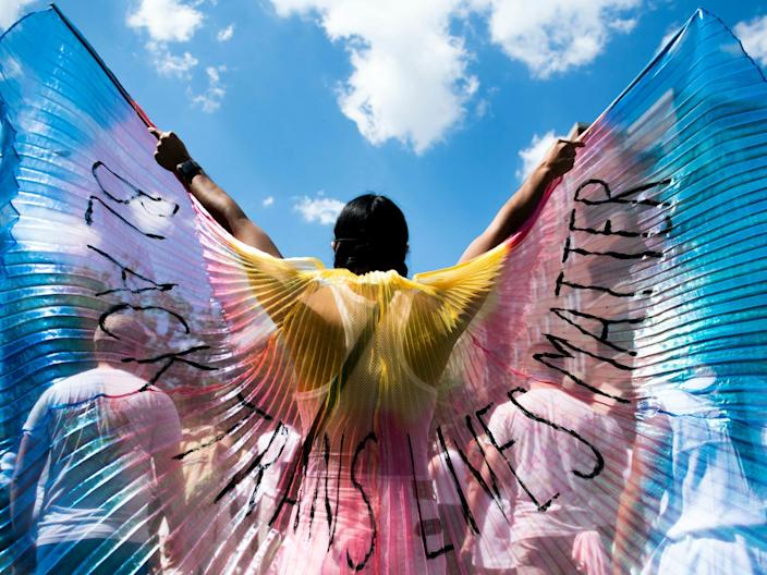 A protestor displays wings while marching on on June 14, 2020 in the Brooklyn borough of New York City.