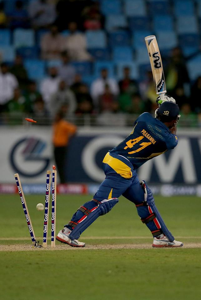 DUBAI, UNITED ARAB EMIRATES - DECEMBER 20:  Seekuge Prassana of Sri Lanka is dismissed by Junaid Khan of Pakistan during the second One-Day International (ODI ) match between Sri Lanka and Pakistan at the Dubai Sports City Cricket Stadium on December 20, 2013 in Dubai, United Arab Emirates.  (Photo by Francois Nel/Getty Images)