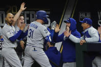 Los Angeles Dodgers' Joc Pederson celebrates in the dugout after his two RBI-single against the Tampa Bay Rays during the seventh inning in Game 4 of the baseball World Series Saturday, Oct. 24, 2020, in Arlington, Texas. (AP Photo/Tony Gutierrez)