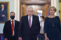 Senate Minority Leader Mitch McConnell, R-Ky., returns to his office from the Senate chamber before votes, at the Capitol in Washington, Thursday, Sept. 30, 2021. (AP Photo/J. Scott Applewhite)