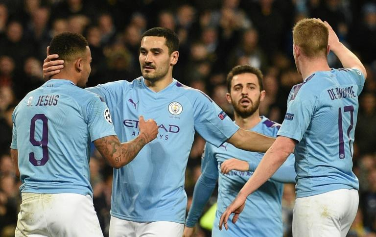Ilkay Gundogan celebrates after scoring in the 1-1 draw with Shakhtar Donetsk that took them through to the last 16