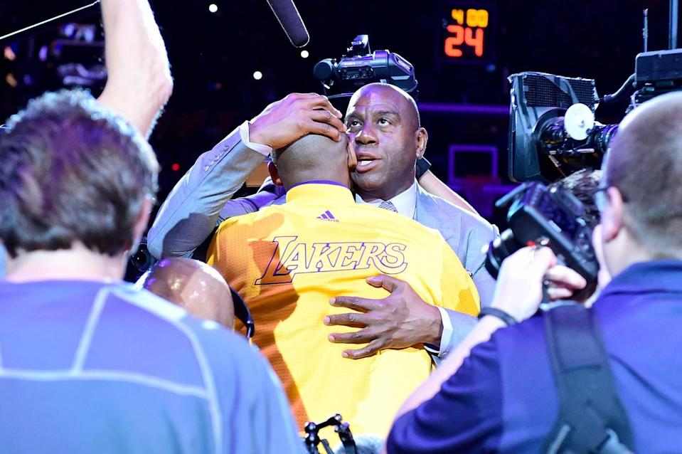 Magic Johnson hugs Kobe Bryant before his final game with the Lakers on April 13, 2016, at Staples Center.
