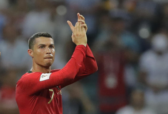 Portugal's Cristiano Ronaldo applauds after the group B match between Portugal and Spain at the 2018 soccer World Cup in the Fisht Stadium in Sochi, Russia, Friday, June 15, 2018. (AP Photo/Sergei Grits)